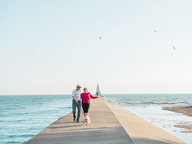 Couple walking on pier, Erieau
