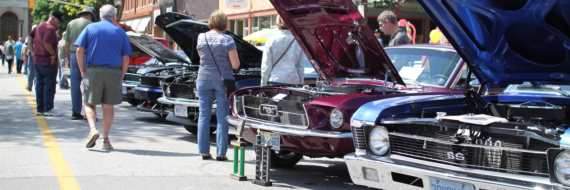people admiring cars at retrofest in downtown chatham